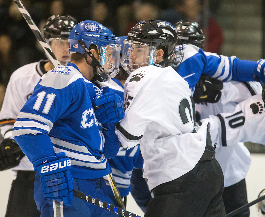 Colby College Forward Tyler Lingel  (11) and Bowdoin College Forward Chris Wallace (25) shove during a NCAA Division III hockey game between Colby College and Bowdoin College on December 5, 2015 at Sidney J. Watson Arena on the campus of Bowdoin College in Brunswick, ME.  (Dustin Satloff)