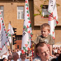 Child and father attend the political gathering of Hungarian far-right political party Jobbik to celebrate the fourth anniversary of their paramilitary group Hungarian Guard (or Magyar Garda in Hungarian) in Budapest, Hungary on August 28, 2011. ATTILA VOLGYI