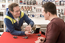 Salesperson explaining bicycle spare parts