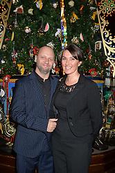 Claridge's  chef SIMON ROGAN and his wife PENNY at the Claridge's Christmas Tree By Dolce & Gabbana Launch Party held at Claridge's, Brook Street, London on 26th November 2013.