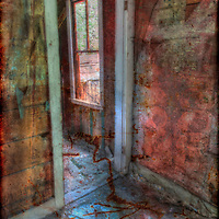 Doorway of an abandoned home offers a glimpse into the past. Ironton, located along southwestern Colorado's Million Dollar Highway, once had a population of 1,000, but became a ghost town when the silver mines crashed. High dynamic range image composited with rusty metal texture.