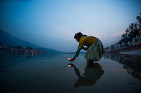 Kid making offering to the Ganga