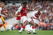 Alex Iwobi Of Arsenal Shoots and scores his teams 2nd goal. <br /> Premier league match, Arsenal v Brighton & Hove Albion at the Emirates Stadium in London on Sunday 1st October 2017. pic by Kieran Clarke, Andrew Orchard sports photography.