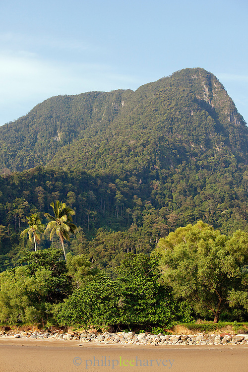 Golden sandy beach and tree covered hillside in Santubong, Kuching, Sarawak, Malaysian Borneo