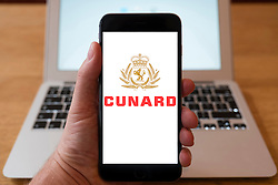 Using iPhone smartphone to display logo of Cunard the cruise line company
