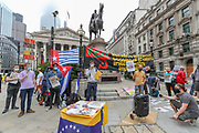 People gathered in front of the Bank of England in Central London on Saturday, Aug 15, 2020, to protest against the Bank of England's decision to hold the Venezuelan gold. <br /> The bars are among the 400,000 bars of gold held in the Bank's vaults, but there is a political dispute about their rightful owner. <br /> The Bank of England is blocking the release of 31 tonnes of gold valued at nearly $1bn(£805m) and intended to combat the coronavirus in Venezuela. (VXP Photo/ Vudi Xhymshiti)