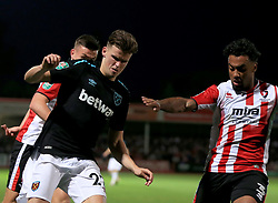 Sam Byram of West Ham United battles with Jordan Cranston of Cheltenham Town - Mandatory by-line: Paul Roberts/JMP - 23/08/2017 - FOOTBALL - LCI Rail Stadium - Cheltenham, England - Cheltenham Town v West Ham United - Carabao Cup