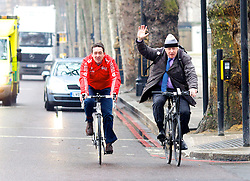"""Mayor of London Boris Johnson he arrives with British Cycling's Chris Boardman before announcing he will create a """"Crossrail for the bike"""" as part of his plans to invest nearly ! 1 billion investment in London cycling, March 7, 2013. Photo by Andre Camara / i-Images."""