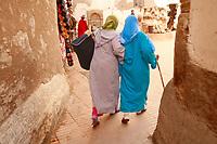 two moslem women friends walking in Morocco