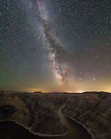 At the end of July I had the chance to shoot the most detailed milky way nightscape photo I've ever taken. Ever since making a similar photo in Utah, I've wanted to repeat it, but finding the right location, the right weather, at the right time isn't easy. After a stunning sunset over Bighorn Canyon National Recreation Area, the clouds cleared out and the conditions began to come together. This image is a combination of 3 separate pictures, totaling nearly 1 hour of exposure time. First I placed my tripod on the edge of the canyon, then aligned my star tracking mount on Polaris (the north star), and then shot two 18-minute exposures of the milky way. Then I turned the tracking mount off, and shot a similar exposure of just the canyon, and later stitched the 3 shots together. Without a tracking mount, I'm normally limited to 30-second exposures before the stars start to blur. In addition to the milky way, the planets Saturn and Mars, and traces of green airglow are also visible. The light pollution along the horizon is from the towns of Lovell and Powell. While I was shooting this, bats kept fluttering around my head, eating all the gnats gathered around the puddles after a recent rain.