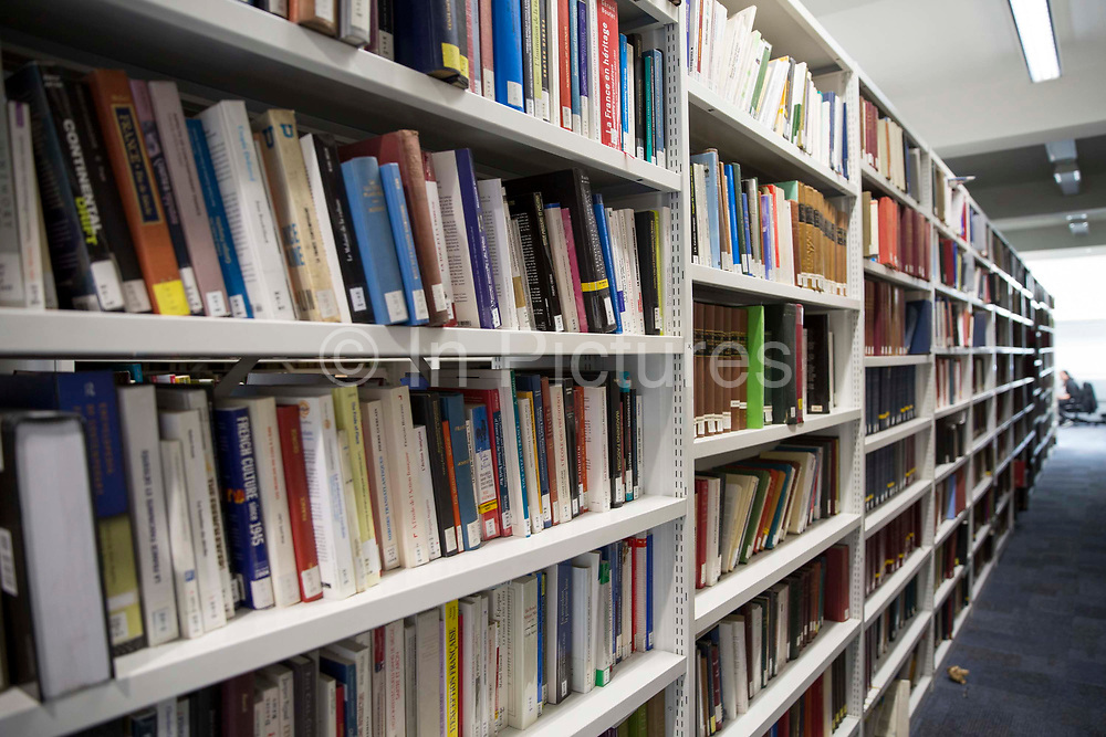 Shelves of library books inside the main LSE library designed by Norman Foster. The London School of Economics and Political Science LSE. Westminster, Central London. One of the leading social science universities in the world with students attending from over 155 different nations.