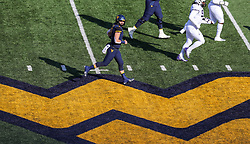 Nov 10, 2018; Morgantown, WV, USA; West Virginia Mountaineers quarterback Will Grier (7) runs across midfield after completing a pass during the third quarter against the TCU Horned Frogs at Mountaineer Field at Milan Puskar Stadium. Mandatory Credit: Ben Queen-USA TODAY Sports