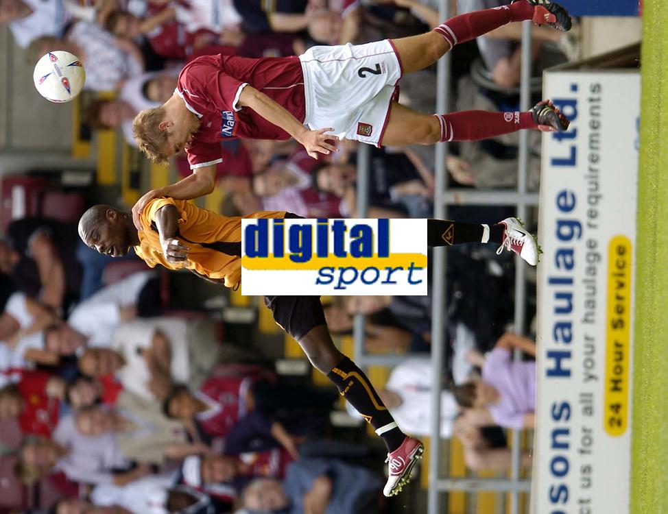 Fotball<br /> Treningskamp England<br /> <br /> Foto: Richard Lane, Digitalsport<br /> NORWAY ONLY<br /> <br /> Northampton Town v Wolverhampton Wanderers<br /> Pre season friendly. 24/07/2004.<br /> <br /> George Ndah is challenged by Luke Chambers
