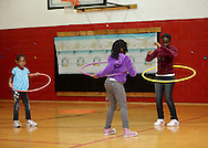 Middletown, New York - Girls play with hula hoops at Family Night at the Middletown YMCA on April 2, 2011.
