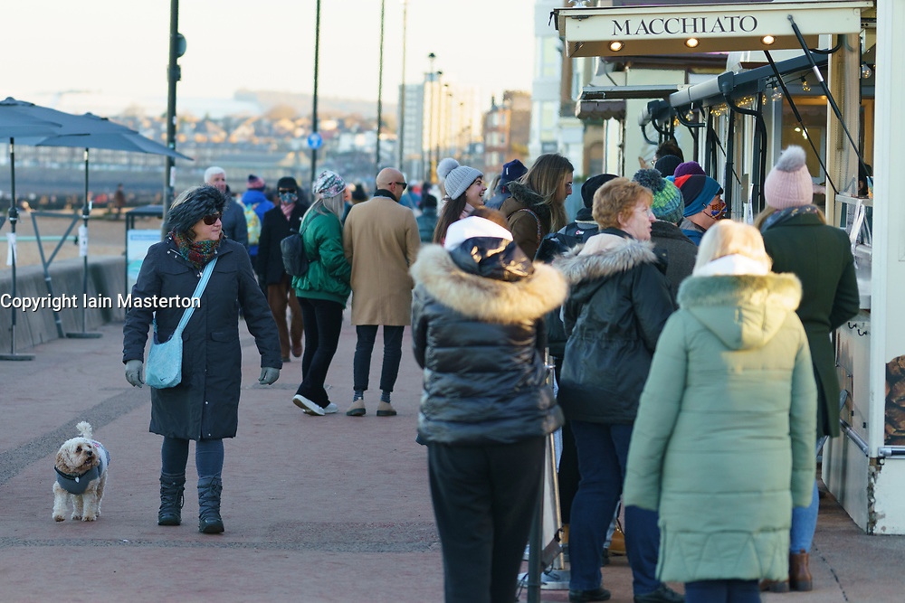 Portobello, Scotland, UK. 8 January 2020. The public flock to Portobello promenade on Friday afternoon as hospitals fill up with new cases of Covid-19 and First Minister Nicola Sturgeon states that an even stricter lockdown in Scotland might be necessary. Very little social distancing in evidence and cafes remain open for takeaway food and drinks. These might be forced to close if a more severe lockdown is enforced. Iain Masterton/Alamy Live News