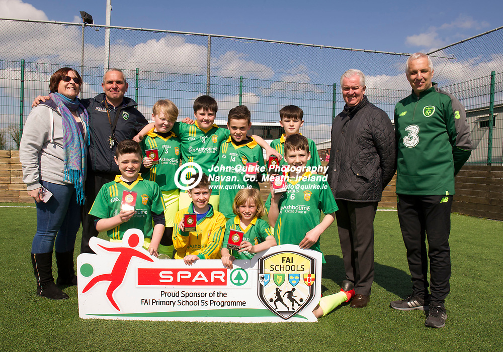 10-04-19. SPAR & FAI Primary School 5's Meath County Final at the MDL Grounds, Navan.<br /> St. Andrew's N.S. Curraha, finalists in the SPAR FAI Primary Schools 5's Boys Div. A Meath County Final, pictured in MDL Grounds, Navan, Meath alongside teachers Niamh Ronan and David Mitchell (Left) and Tony St. Leger, BWG Foods, SPAR representative and FAI Co-Ordinator Brian Donnelly. Curraha will progress to the Leinster Finals on May 16th with a chance to go all the way to the National Finals in the Aviva Stadium on May 29th.<br /> The SPAR FAI Primary Schools 5s Programme is the largest primary schools' competition in the country with 36,616 students from 1,691 schools participating in a fun, safe and inclusive environment. <br /> Photo: John Quirke / www.quirke.ie<br /> ©John Quirke Photography, Unit 17, Blackcastle Shopping Cte. Navan. Co. Meath. 046-9079044 / 087-2579454.