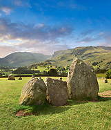 View of neolthic Castlerigg Stone Circle monaliths and the Lake District, England,  built circa 2500 BC.<br /> <br /> Castlerigg Stone Circle was built around 4500 years ago by prehistoric farming communities who settles in the fertile valleys of the Lake District.  Current thinking has linked Castlerigg with the Neolithic Langdale axe industry in the nearby Langdale fells: the circle may have been a meeting place where these axes were traded or exchanged. Ritually deposited stone axes have been found all over Britain, suggesting that their uses went far beyond their practical capabilities. Exchange or trading of stone axes may not have been possible without first taking part in a ritual or ceremony. .<br /> <br /> Visit our PREHISTORIC PLACES PHOTO COLLECTIONS for more  photos to download or buy as prints https://funkystock.photoshelter.com/gallery-collection/Prehistoric-Neolithic-Sites-Art-Artefacts-Pictures-Photos/C0000tfxw63zrUT4