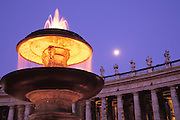 Fountain in the Vatican courtyard with full moon