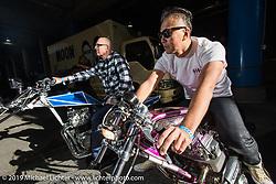 Kiyo Mitsuhiro Kiyonaga and Duane Ballard staging for the grand entry into the Annual Mooneyes Yokohama Hot Rod and Custom Show. Japan. Sunday, December 7, 2014. Photograph ©2014 Michael Lichter.