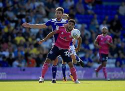 Birmingham City's Gary Gardner (Left) and Queens Park Rangers' Massimo Luongo contest a header.