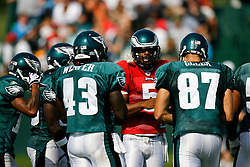 Philadelphia Eagles quarterback Donovan McNabb #5 in a huddle during the Philadelphia Eagles NFL training camp in Bethlehem, Pennsylvania at Lehigh University on Saturday August 8th 2009. (Photo by Brian Garfinkel)