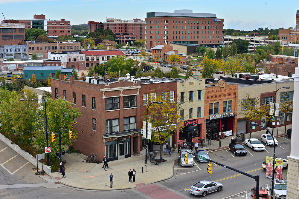 Cityscape of a row of destinations on S Main St.