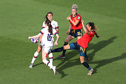 USA's Rose Lavelle (left) is fouled by Spain's Virginia Torrecilla (right) and is awarded a penalty