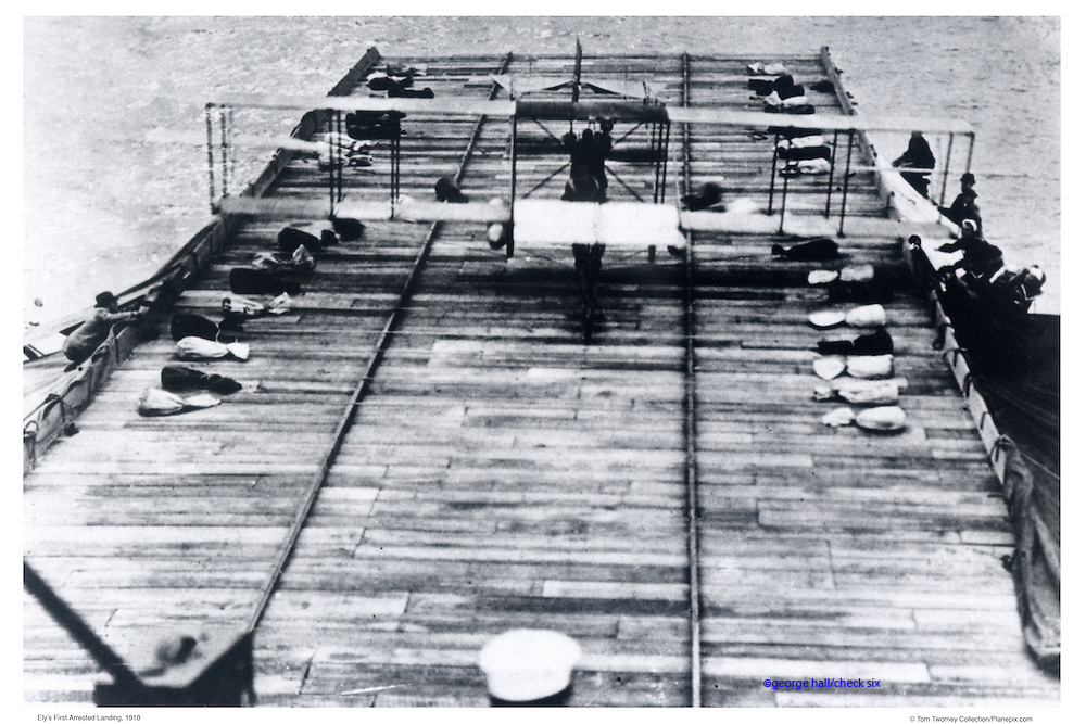 """Biplane on first aircraft carrier """"Ely'."""