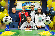 Sarina Bolden and her family pose with a duplicate National Letter of Intent to play soccer at the Loyola Marymount University during the NCAA National Signing Day event at Milpitas High School in Milpitas, California, on February 4, 2015. (Stan Olszewski/SOSKIphoto)