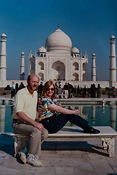 John and Hilary who have travelled the world extensively.  pictured at the Taj Mahal in India, 2009.<br /> John and Hilary Bond who met in Majorca at Club 18-30 in May 1973 where John was a Rep and Hilary a guest. This year the couple have just celebrated their 44th wedding anniversary. Watford, Herts, May 29 2018.