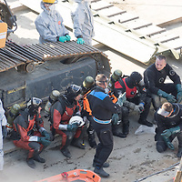 Rescue personnel prepare to recover bodies from the passenger boat Hableany (means Mermaid in Hungarian) lifted up from the river after it's capsize in an accident on river Danube in downtown Budapest, Hungary on June 11, 2019. ATTILA VOLGYI