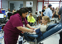 Oct 2, 2017 - Las Vegas, Nevada, U.S. - Creech Air Force Base Master Sgt. ANNA LANSDELL, right, donates blood and is attended by MARIA REYES at United Blood Services. A mass shooting occurred late Sunday evening at the Route 91 Harvest music festival on The Las Vegas Strip. (Credit Image: © Ronda Churchill via ZUMA Wire)