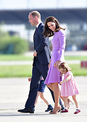 The Duke and Duchess of Cambridge as they walk to board a plane in Hamburg with Prince George and Princess Charlotte at the end of their visit to Germany.