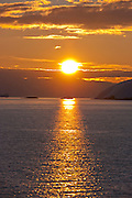 Sunset on the Antarctic Peninsula, seen from  the Scandinavian-built ice-breaker Akademik Sergey Vavilov, originally built for the Russian Academy of Science and still used occasionally by scientists. It is now predominantly used for adventure touring.