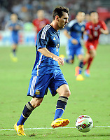 Lionel Messi of Argentina dribbles against Hong Kong during a friendly football match in Hong Kong, China, 14 October 2014.<br /> <br /> Lionel Messi needed just six minutes to make his mark in Argentina's 7-0 rout of Hong Kong in a friendly at Hong Kong Stadium on Tuesday (14 October 2014). The Barcelona star Messi scored twice after going on as a substitute for the last 30 minutes of the game to celebrate the 100th anniversary of the Hong Kong Football Association. Napoli striker Gonzalo Higuain and Benfica's Nicolas Gaitan also scored two goals each after Sevilla's Ever Banega had opened scoring in the 19th minute.