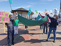 Extinction Rebellion awareness-raising march r on New Brighton Seafront, after a short speech making demands the marched along the seafront. New Brighton, Wirral.