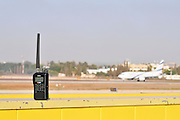 Israel, Ben-Gurion international Airport two-way radio with an El Al Boeing ready for takeoff in the background