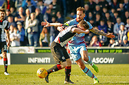 Martin Woods(C) of Dundee FC gets a hold of Anders Dreyer of St Mirren during the Ladbrokes Scottish Premiership match between St Mirren and Dundee at the Paisley 2021 Stadium, St Mirren, Scotland on 30 March 2019.