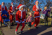 Entusiasm as contestants start - Thosuands of runners, of all ages, in santa suits and other Christmas costumes runaround Clapham Common for Great Ormond Street Hospital and for fun. London 30 Nov 2016