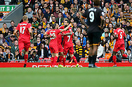 Adam Lallana of Liverpool FC (20) celebrates with his teammates after scoring his teams 1st goal. Premier League match, Liverpool v Hull City at the Anfield stadium in Liverpool, Merseyside on Saturday 24th September 2016.<br /> pic by Chris Stading, Andrew Orchard sports photography.