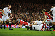 Jonathan Davies of Wales is tackled by England's Tom Youngs and Owen Farrell. RBS Six nations championship 2013, Wales v England at the Millennium stadium in Cardiff , South Wales on Saturday 16th March 2013. pic by Andrew Orchard, Andrew Orchard sports photography,