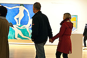 people walking in the gallery with Matisse painting Dance 1 in the Museum of Modern Art in New York