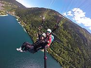 Paragliding over Lake Molveno and Dolomites, UNESCO world heritage site, Italy.