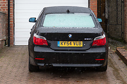 London, December 27 2017. The Southgate, London home of alleged war criminal Chowdhury Mueen-Uddin who was convicted and sentenced to death in his absence for war crimes in Bangladesh during the 1971 Bangladeshi war of independence. Pictured a luxury 5-series BMW parked on Mueen-Uddin's drive. © SWNS