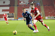 Aberdeen forward Marley Watkins (50) drives past Hamilton Academicals Scott Martin (8) during the Scottish Premiership match between Aberdeen and Hamilton Academical FC at Pittodrie Stadium, Aberdeen, Scotland on 20 October 2020.