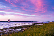 A Windjammer sailboat takes tourists on a sunset cruise in Merriconeag Sound along Orrs Island, Maine.