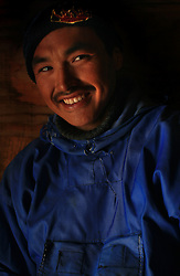 Inuit hunter Tobias Simigaq. A changing climate - which shows itself in warming temperatures, earlier summers, later winters, and shrinking and thinning sea ice - threatens the livelihoods and traditions of some of the last subsistence hunters on Earth, the Polar Inuit communities of far Northwest Greenland.