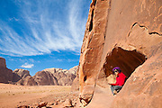 Leora Leshem relaxes in an alcove set into a sandstone cliff in Wadi Rum, Jordan.