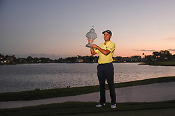 February 25, 2018 - Palm Beach Gardens, Florida, U.S. - Justin Thomas poses for a picture holding the Honda Classic trophy after winning the tournament on the first playoff hole at PGA National Resort and Spa in Palm Beach Gardens, Fla., on Sunday, February 25, 2018. (Credit Image: © Andres Leiva/The Palm Beach Post via ZUMA Wire)