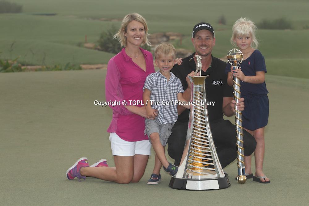 Henrik STENSON (SWE)  with wife Emma,daughter Lisa and son Karl during fourth round DP World Tour Championship 2013,Jemeirah Golf Estates, Dubai,UAE.